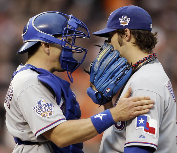 Texas Rangers catcher Matt Treanor talks to starter C.J. Wilson during the second inning of Game 2 of baseball's World Series against the San Francisco Giants Thursday, Oct. 28, 2010, in San Francisco. (AP Photo/David J. Phillip)
