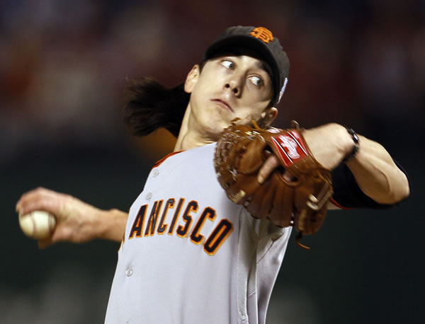 San Francisco Giants' Tim Lincecum throws during the first inning of Game 5 of baseball's World Series against the Texas Rangers Monday, Nov. 1, 2010, in Arlington, Texas. (AP Photo/Matt Slocum)