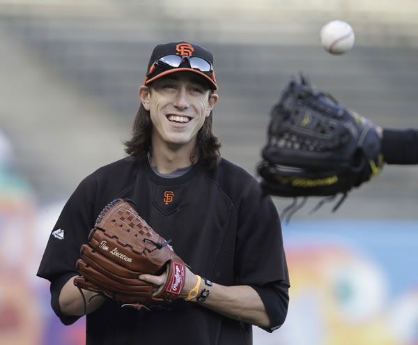 San Francisco Giants starting pitcher Tim Lincecum plays catch in the outfield during a baseball workout at AT&T Park in San Francisco, Monday, Oct. 25, 2010. The Giants and the Texas Rangers are scheduled to play Game 1 of the World Series on Wednesday. (AP Photo/Eric Risberg)