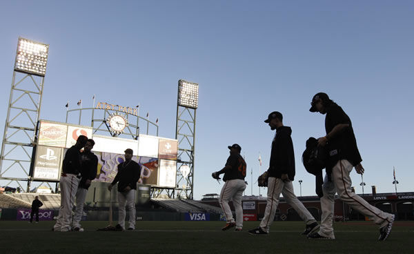 The San Francisco Giants take the field for practice for Game 1 of baseball's World Series against the Texas Rangers Tuesday, Oct. 26, 2010, in San Francisco. (AP Photo/David J. Phillip)