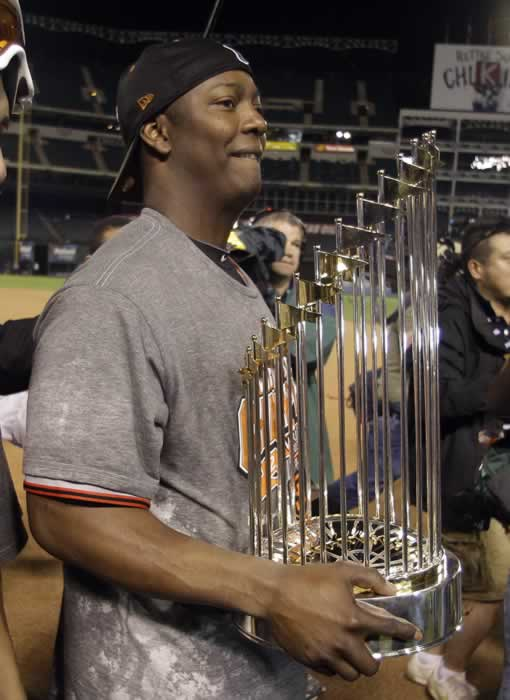 San Francisco Giants' Edgar Renteria holds the championship trophy after Game 5 of baseball's World Series against the Texas Rangers Monday, Nov. 1, 2010, in Arlington, Texas. The Giants won 3-1 to capture the World Series. (AP Photo/Tony Gutierrez)