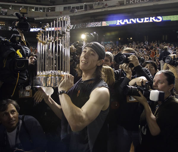 San Francisco Giants' Tim Lincecum celebrates after Game 5 of baseball's World Series against the Texas Rangers Monday, Nov. 1, 2010, in Arlington, Texas. The Giants won 3-1 to capture the World Series. (AP Photo/Tony Gutierrez)