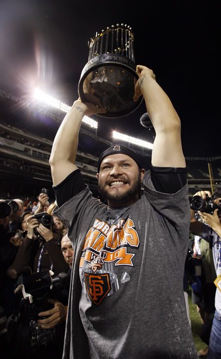 San Francisco Giants' Cody Ross holds the championship trophy after Game 5 of baseball's World Series against the Texas Rangers Monday, Nov. 1, 2010, in Arlington, Texas. The Giants won 3-1 to capture the World Series. (AP Photo/Matt Slocum)