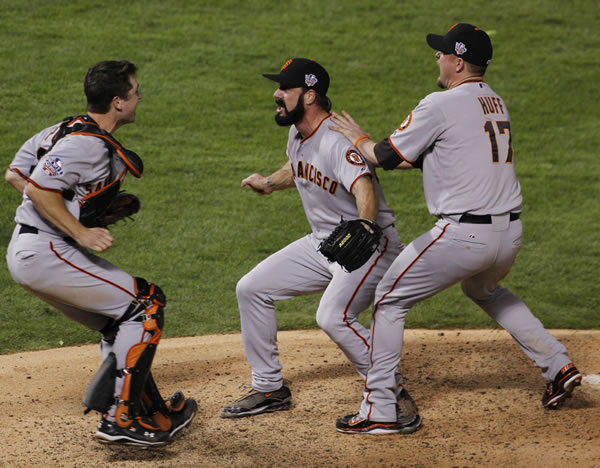 San Francisco Giants Brian Wilson celebrates with Buster Posey, left and Aubrey Huff, right after winning the World Series in Game 5 of baseball's World Series against the Texas Rangers Monday, Nov. 1, 2010, in Arlington, Texas. The Giants won 3-1 to capture the series. (AP Photo/David J. Phillip)