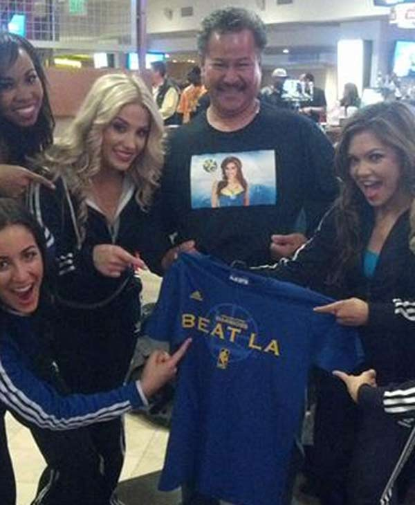 "<div class=""meta ""><span class=""caption-text "">Warriors fan with cheerleaders (Submitted via uReport by Negda)</span></div>"