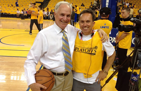 Mike Shumann and photographer Abe Mendoza at the Warriors game.
