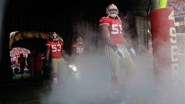 San Francisco 49ers outside linebacker Ahmad Brooks (55) prepares to run out onto the field before playing the New Orleans Saints in an NFL divisional playoff football game Saturday, Jan. 14, 2012, in San Francisco. (AP Photo/Marcio Jose Sanchez)