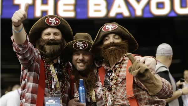 From left, San Francisco 49ers fans Vince Knoss, Ryan Knoss and Gibran Farrah, all of San Francisco, cheer before the NFL Super Bowl XLVII.