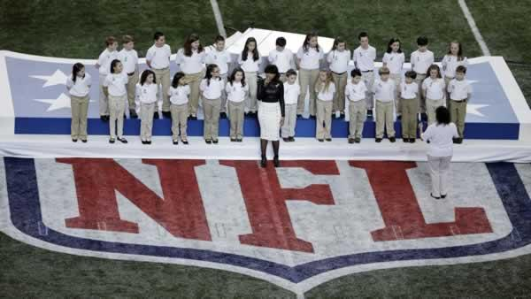 Jennifer Hudson performs with students from Sandy Hook Elementary School before the NFL Super Bowl XLVII football game between the San Francisco 49ers and the Baltimore Ravens Sunday, Feb. 3, 2013, in New Orleans. (AP Photo/Charlie Riedel)