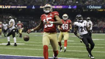 San Francisco 49ers wide receiver Michael Crabtree (15) reacts after scoring a 31-yard touchdown during the second half of the NFL Super Bowl XLVII football game against the Baltimore Ravens, Sunday, Feb. 3, 2013, in New Orleans. (AP Photo/Matt Slocum)