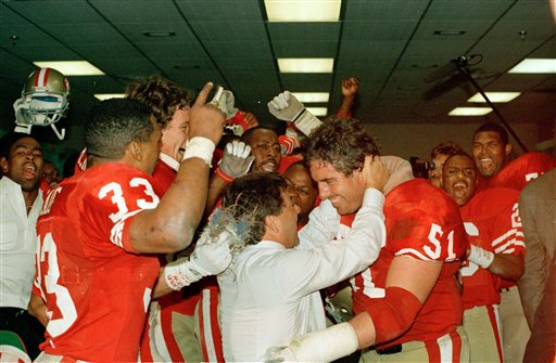Super Bowl XXIII:  San Francisco 49ers owner Edward J. DeBartolo hugs 49ers center Randy Cross, right, after the 49ers victory over the Cincinnati Bengals in SuperBowl XXIII in Miami Sunday, Jan. 22, 1989. Cross has announced plans to retire after this season. <span class=meta>(AP Photo&#47;Al Behrman)</span>