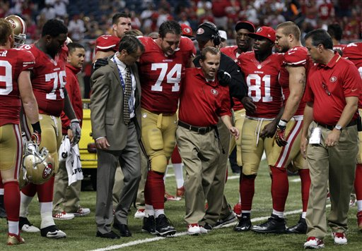 San Francisco 49ers offensive tackle Joe Staley &#40;74&#41; is helped off the field during the fourth quarter of an NFL football game against the St. Louis Rams Thursday, Sept. 26, 2013, in St. Louis. <span class=meta>(AP Photo&#47;Tom Gannam)</span>