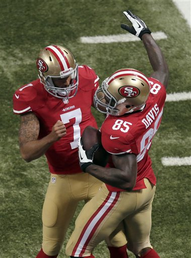 San Francisco 49ers quarterback Colin Kaepernick, left, congratulates tight end Vernon Davis on his 12-yard touchdown reception during the third quarter of an NFL football game against the St. Louis Rams on Thursday, Sept. 26, 2013, in St. Louis.  <span class=meta>(AP Photo&#47;Charlie Riedel)</span>