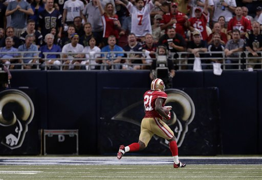 San Francisco 49ers running back Frank Gore, left, runs with the ball on his way to a 34-yard touchdown during the second quarter of an NFL football game against the St. Louis Rams Thursday, Sept. 26, 2013, in St. Louis.  <span class=meta>(AP Photo&#47;Charlie Riedel)</span>