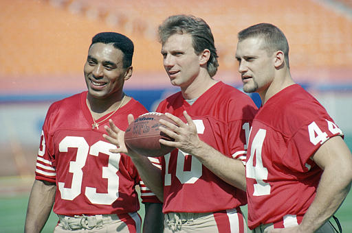 49ers Montana Craig Rathman 1989: San Francisco 49ers&#39; quarterback Joe Montana, center, holds a football as he poses for pictures with running back Roger Craig, left, and fullback Tom Rathman during SuperBowl Media Day, Jan. 17, 1989, in Miami. <span class=meta>(AP Photo&#47;Al Behrman)</span>