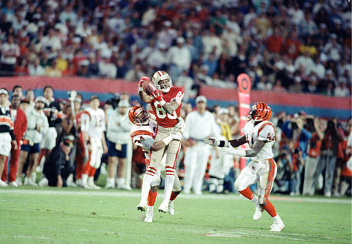 SUPER BOWL BENGALS 49ERS: San Francisco 49ers wide receiver Jerry Rice &#40;80&#41; is surrounded by Cincinnati Bengals defenders, cornerback Lewis Billups, left, and safety Ray Horton, as he pulls in a long pass during the fourth quarter of SuperBowl XXIII at Joe Robbie Stadium in Miami, Fla., Sunday, Jan. 22, 1989. Rice was named Most Valuable Player after the 49ers won, 20-16. <span class=meta>(AP Photo&#47;Phil Sandlin)</span>
