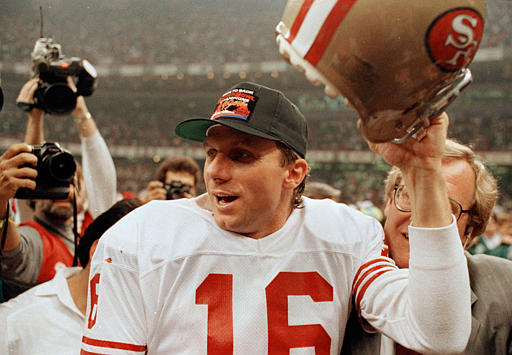 NFL Hall of Famers: San Francisco 49ers quarterback Joe Montana raises his helmet toward the crowd as he leaves the field following the team&#39;s 55-10 victory over the Denver Broncos in the SuperBowl in New Orleans, La., Jan. 28, 1990. <span class=meta>(AP Photo&#47;Lennox McLennon)</span>