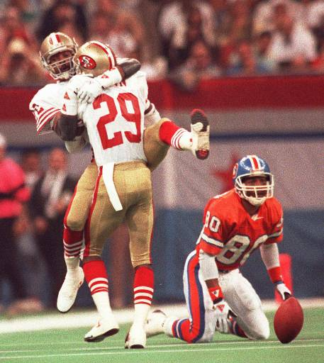SUPER BOWL XXIV San Francisco 49ers Don Griffin &#40;29&#41; and Tim McKyer &#40;22&#41; celebrate after breaking up a Denver Broncos pass from John Elway to wide receiver Mark Jackson, right, during SuperBowl XXIV in New Orleans, La., Jan. 28, 1990. <span class=meta>(AP Photo&#47;Reed Saxon)</span>