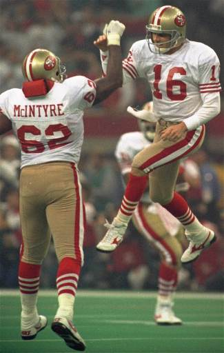 San Francisco 49ers quarterback Joe Montana &#40;16&#41; leaps for a high-five with teammate Guy McIntyre after a third-quarter touch down in SuperBowl XXIV on January 28, 1990 in New Orleans. Montana was named MVP. <span class=meta>(AP Photo&#47;Mark Duncan)</span>