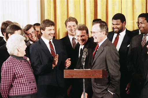MRS. BUSH LAUGHS WITH SAN FRANCISCO 49ERS QUARTERBACK JOE MONTANA  Overview   President and Mrs. Bush share a laugh with San Francisco 49ers quarterback Joe Montana, center right,   linebacker Michael Walter, center left, and other team members during a meeting with the Superbowl   champions in the White House in Washington, Tuesday, Feb. 27, 1990. <span class=meta>(AP Photo&#47;Barry Thumma)</span>