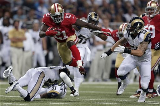 San Francisco 49ers running back Frank Gore &#40;21&#41; runs with the ball for an 18-yard gain during the first quarter of an NFL football game as St. Louis Rams linebacker James Laurinaitis, right, gives chase Thursday, Sept. 26, 2013, in St. Louis. <span class=meta>(AP Photo&#47;Charlie Riedel)</span>