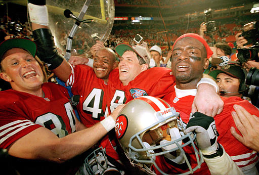 Super Bowl XXIX 49ers Chargers 1995 San Francisco 49ers, from left, Brent Jones, William Floyd, Steve Young and Merton Hanks, celebrate after SuperBowl XXIX, Jan. 29, 1995 at Miami&#39;s Joe Robbie Stadium, after defeating the San Diego Chargers. Young was named Most Valuable Player. <span class=meta>(AP Photo&#47;Susan Walsh)</span>
