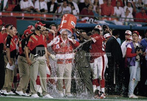 Super Bowl XXIX: San Francisco 49ers coach George Seifert is doused with ice water late in the fourth quarter of his team&#39;s 49-26 win over the San Diego Chargers in SuperBowl XXIX, Sunday, Jan. 29, 1995 in Miami. It was the 49ers&#39; fifth SuperBowl victory - the most by any NFL team. <span class=meta>(AP Photo&#47;Lynne Sladky)</span>