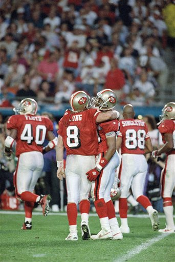 FOOTBALL GAMES 1995 SUPER BOWL XXIX SAN DIEGO VS SAN FRANCISCO  Overview   San Francisco 49ers quarterback Steve Young, left, hugs teammate Jerry Rice after a third quarter touchdown reception against the San Diego Chargers in Super Bowl XXIX on Jan. 29, 1995 in Miami. <span class=meta>(AP Photo&#47;Eric Risberg)</span>
