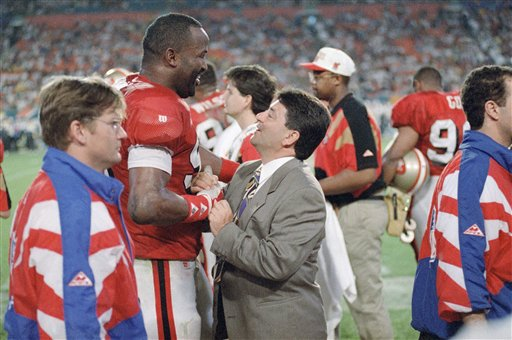 Football Games 1995 Super Bowl XXIX San Diego vs San Francisco: San Francisco 49ers owner Ed DeBartolo Jr. is greeted by 49ers defensive end Tim Harris near the end of  SuperBowl XXIX as the 49ers defeated the San Diego Chargers, 49-26, on Sunday, Jan. 29, 1995 at Joe Robbie  Stadium in Miami. <span class=meta>(AP Photo)</span>