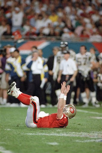 "<div class=""meta ""><span class=""caption-text "">Football Games 1995 Super Bowl XXIX San Diego vs San Francisco: San Francisco 49ers quarterback Steve Young signals a touchdown after a third quarter touchdown pass to Jerry Rice against the San Diego Chargers in SuperBowl XXIX, on Sunday, Jan. 29, 1995 at Joe Robbie Stadium in Miami. Young set a SuperBowl record with six touchdowns passed and was named Most Valuable Player of the game. (AP Photo/Doug Mills)</span></div>"