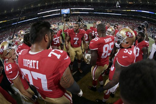 San Francisco 49ers quarterback Colin Kaepernick &#40;7&#41; pumps up his team before the start of an NFL football game between the St. Louis Rams and the San Francisco 49ers Thursday, Sept. 26, 2013, in St. Louis. <span class=meta>(AP Photo&#47;Charlie Riedel)</span>