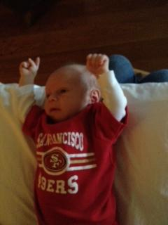 "<div class=""meta ""><span class=""caption-text "">Looks like one-month old Jacob Silva of Oakland is reacting to the Alex Smith Vernon Davis pass completion. (Photo submitted via uReport)</span></div>"