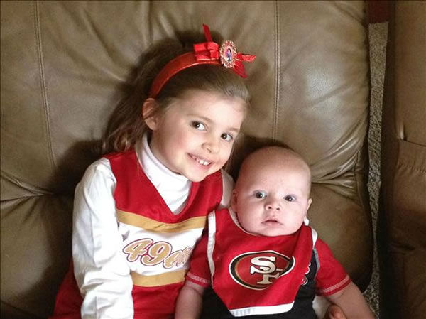 "<div class=""meta ""><span class=""caption-text "">Kylie (4) and Ryan (3 months) Wisely, cheering on the 49ers. (Anonymous)</span></div>"