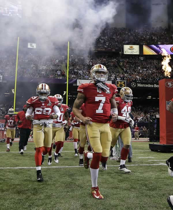 San Francisco 49ers quarterback Colin Kaepernick (7) runs onto the field with teammates before the NFL Super Bowl XLVII football game against the Baltimore Ravens Sunday, Feb. 3, 2013, in New Orleans. (AP Photo/Matt Slocum)