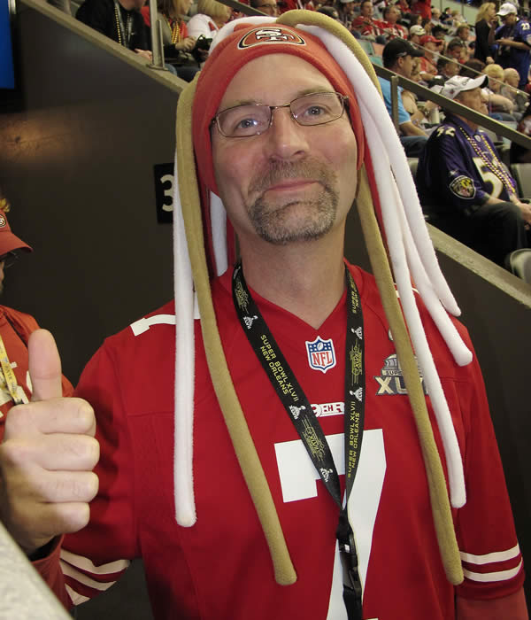 A 49ers fan gives a thumbs up.