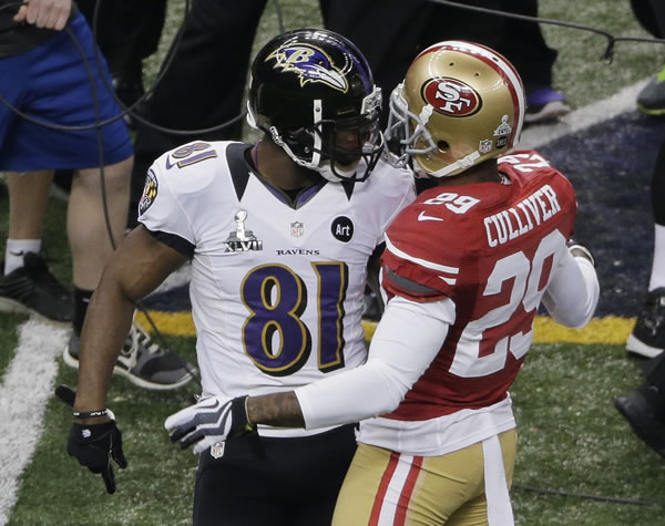 Baltimore Ravens wide receiver Anquan Boldin (81) and San Francisco 49ers defensive back Chris Culliver (29) exchange words during the first half of the NFL Super Bowl XLVII football game Sunday, Feb. 3, 2013, in New Orleans. (AP Photo/Charlie Riedel)