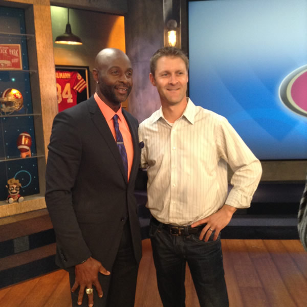 Sports Producer Colin Resch and 49ers legend Jerry Rice pose for a photo in the ABC7 News studio. <span class=meta>(KGO)</span>
