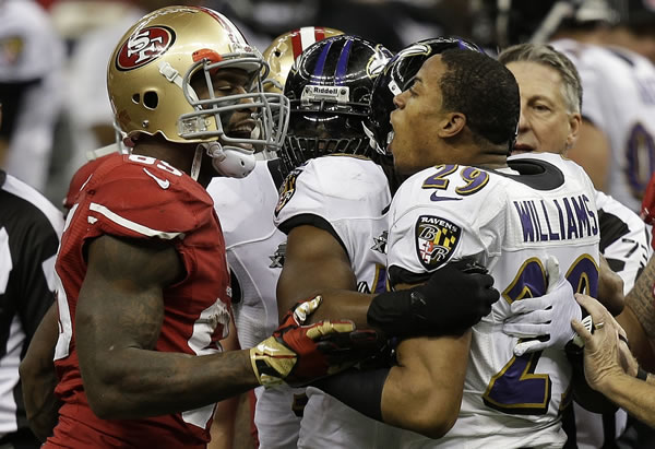 San Francisco 49ers tight end Vernon Davis (85) and Baltimore Ravens cornerback Cary Williams (29) argue during the first half of NFL Super Bowl XLVII football game, Sunday, Feb. 3, 2013, in New Orleans. (AP Photo/Gene Puskar)