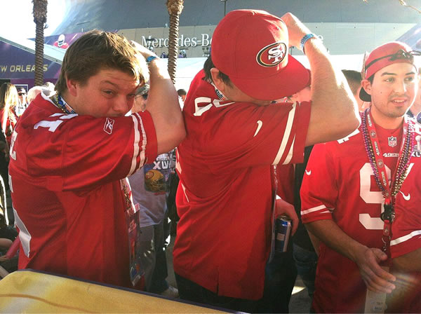 Three guys Kaepernicking before the big game!