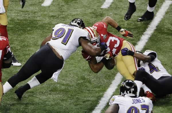 San Francisco 49ers running back LaMichael James (23) fumbles the ball as he is hit by Baltimore Ravens linebacker Courtney Upshaw (91) and Corey Graham (24) during the first half of the NFLSuper Bowl XLVII football game Sunday, Feb. 3, 2013, in New Orleans. (AP Photo/Charlie Riedel)