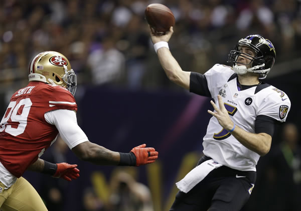 Baltimore Ravens quarterback Joe Flacco (5) throws a pass over San Francisco 49ers linebacker Aldon Smith (99) during the first half of the NFL Super Bowl XLVII football game, Sunday, Feb. 3, 2013, in New Orleans. (AP Photo/Evan Vucci)