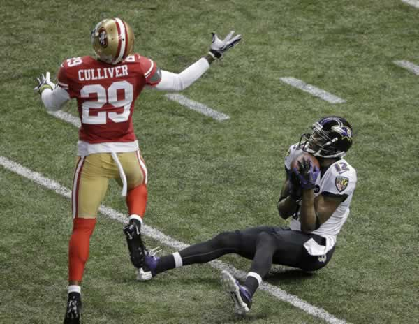 Baltimore Ravens wide receiver Jacoby Jones (12) catches a pass in front of San Francisco 49ers defensive back Chris Culliver (29) during the first half of the NFL Super Bowl XLVII football game Sunday, Feb. 3, 2013, in New Orleans. (AP Photo/Charlie Riedel)