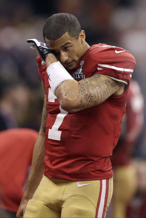 San Francisco 49ers quarterback Colin Kaepernick (7) wipes his face after losing 34-31 to the Baltimore Ravens in the NFL Super Bowl XLVII football game, Sunday, Feb. 3, 2013, in New Orleans. (AP Photo/David Goldman)