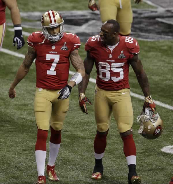 San Francisco 49ers tight end Vernon Davis (85) and quarterback Colin Kaepernick (7) talk between plays against the Baltimore Ravens during the first half of the NFL Super Bowl XLVII football game, Sunday, Feb. 3, 2013, in New Orleans. (AP Photo/Gerald Herbert)