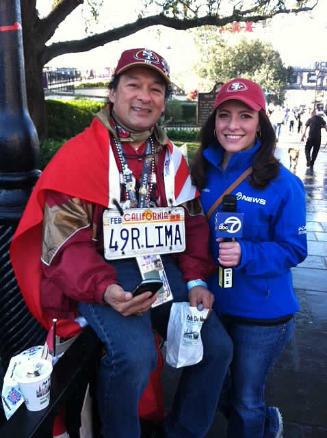 @KatieABC7 poses for a photo with a 49ers fan.