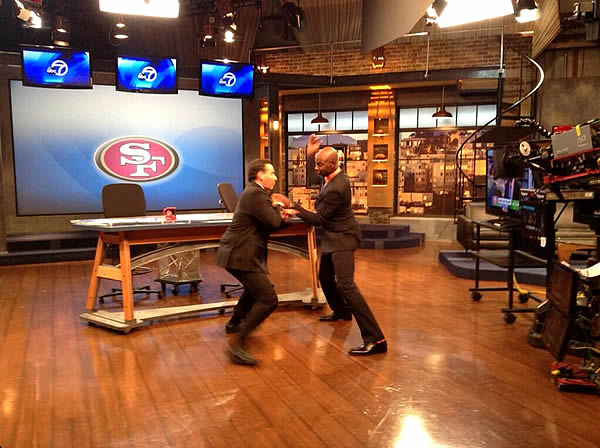 Sports Anchor Larry Beil and 49ers legend Jerry Rice playing ball in the ABC7 News studio. <span class=meta>(KGO)</span>