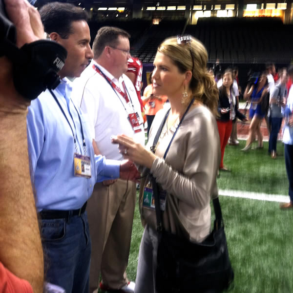 ABC7's Larry Beil interviews Sarah Harbaugh .