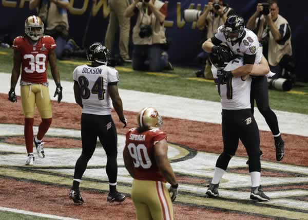 Baltimore Ravens tight end Dennis Pitta (88) celebrates with center Matt Birk (77) after his 1-yard touchdown reception on a throw from quarterback Joe Flacco against the San Francisco 49ers during the second quarter of the NFL Super Bowl XLVII football game, Sunday, Feb. 3, 2013, in New Orleans. 49ers' Dashon Goldson (38) and Isaac Sopoaga (90) look on as Ravens' Ed Dickson (84) joins in. (AP Photo/Gerald Herbert)