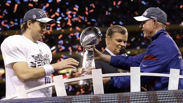 "<div class=""meta ""><span class=""caption-text "">New York Giants head coach Tom Coughlin, right, hands the Vince Lombardi Trophy to quarterback Eli Manning after their 21-17 win over the New England Patriots in the NFL Super Bowl XLVI football game, Sunday, Feb. 5, 2012, in Indianapolis. (AP Photo/David J. Phillip)</span></div>"