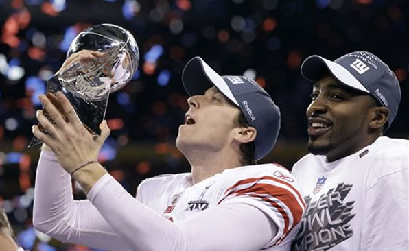 New York Giants kicker Lawrence Tynes holds the Vince Lombardi Trophy after his team's 21-17 win over the New England Patriots in the NFL Super Bowl XLVI football game Sunday, Feb. 5, 2012, in Indianapolis. (AP Photo/David J. Phillip)